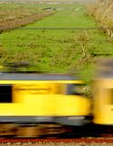A running train. Against the background of the Dutch meadows Royalty Free Stock Image