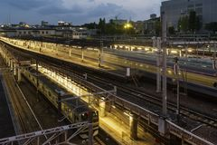 Running train and beautiful view of Ueno Station in the blue hour, Tokyo, Japan stock image