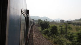 Running train on railways, Vietnam. Train route from Hue to Ho Chi Minh City stock video footage