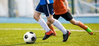Football match for young players. Training and football soccer tournament for children. Youth soccer competition. Running Training for Soccer. Soccer Players royalty free stock photo