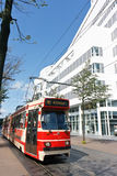 Running Tram in front of the City Hall. Red Tram of The Hague passing in front the City Hall royalty free stock images