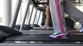 Running on the treademill, exercise on cardio fitness equipment. Gym stock video footage