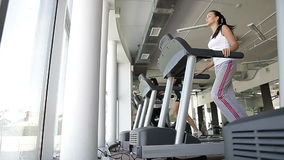 Running on the treademill, exercise on cardio fitness equipment. Gym stock video
