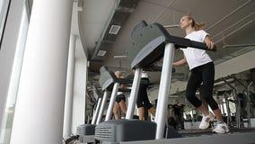Running on the treademill stock footage