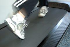 Running on treadmill 2. Motion blurred stock photo