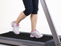 Running on treadmill. Woman is running on a treadmill Stock Images