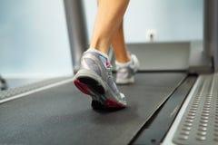 Running on treadmill. Image of female foot running on treadmill Stock Photography