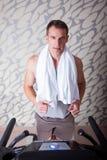 Running on treadmill Royalty Free Stock Photos
