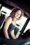 Running on treadmill in gym Royalty Free Stock Images