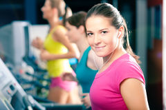 Running on treadmill in gym Stock Image