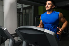 Running on treadmill in gym Stock Photography