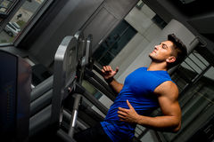 Running on treadmill in gym Royalty Free Stock Photos
