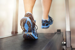 Running on treadmill Royalty Free Stock Photos