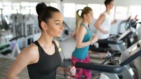 Running on Treadmill. People running on treadmill at gym stock video