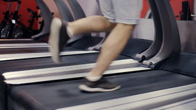 Running on a treadmill slow motion stock video footage
