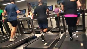 Running in treadmill in slow motion stock footage