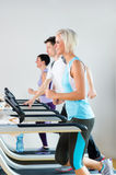 Running on treadmill young people fitness center Royalty Free Stock Image