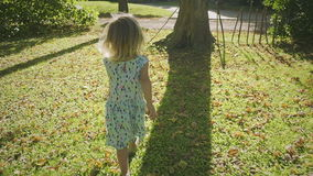 Running Between the Trees. Little Girl Running Between the Trees, Slow Motion stock video footage