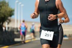 Running triathlon athlete man,running. On triathlon race on sunny days Stock Photos