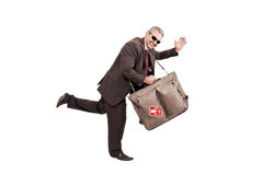 Running for trip. Business man going to a trip isolated on white background Royalty Free Stock Image