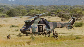 Running troops. ROODEWAL, SOUTH AFRICA -MAY 08: Troops running from an Oryx helicopter during the SAAF Air Power Capability Demonstration on May. 08, 2013 at the Stock Photos