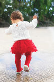 Running trought puddles Royalty Free Stock Image