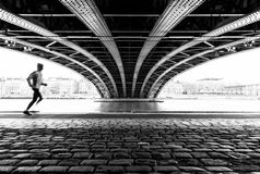 Running under the bridge royalty free stock photography