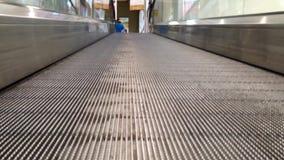 Running up escalators. To entrance door stock video footage