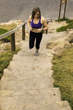 Running up steps woman athlete female Stock Photography
