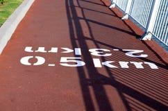 Running and walking lane. This lane is exclusive for running and walking and shows the distance in kilometers stock image