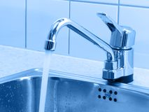 Running water. Closeup of faucet with flowing water stock photo