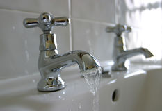 Running Water Bathroom Taps Stock Photos