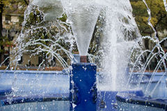 Running water on city fountain.Splash water. Image of running water from all hoses of city fountain in Subotica, Serbia. Filmed on sunny day, about noon. In the stock photography