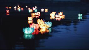 Running water flashlight. The glow of lanterns on the water at night. Romantic evening. Beautiful floating water stock video
