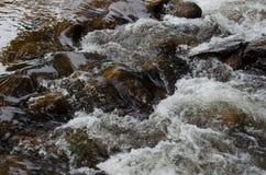 Running Water over Rock stock photo