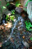 Running water over rocks. This is the slow formation of the lines under the water running over rocks Stock Photos