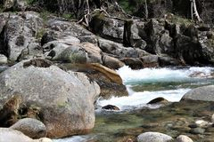 Running water and rocks royalty free stock photography