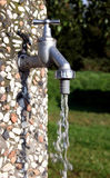 Running water tap. In a garden Stock Photos