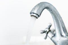 Running water tap closeup Stock Photos