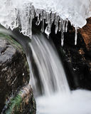Running waterfall and ice Royalty Free Stock Images