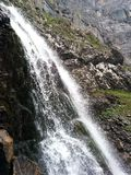 Running waterfall. Running waterfaal from mountain in Switzerland stock photo