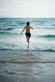 Running on the waves Royalty Free Stock Photo