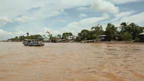 Running waves of the Vietnamese river. Shooting in motion. View from the boat.  stock footage
