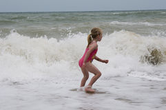 Running through the waves Stock Images