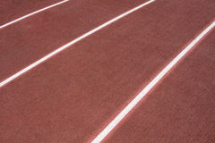 The running ways at the stadium with artificial coating of rubber Stock Photos