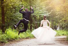 Running wedding couple Stock Photography