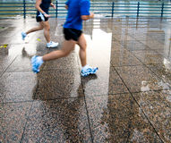 Running on a Wet Evening Royalty Free Stock Images