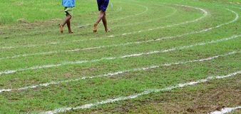 Running on white lines track. In football Sports stadium Royalty Free Stock Image