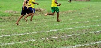 Running on white lines track. In football Sports stadium Stock Photo