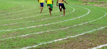 Running on white lines track. In football Sports stadium Stock Photos